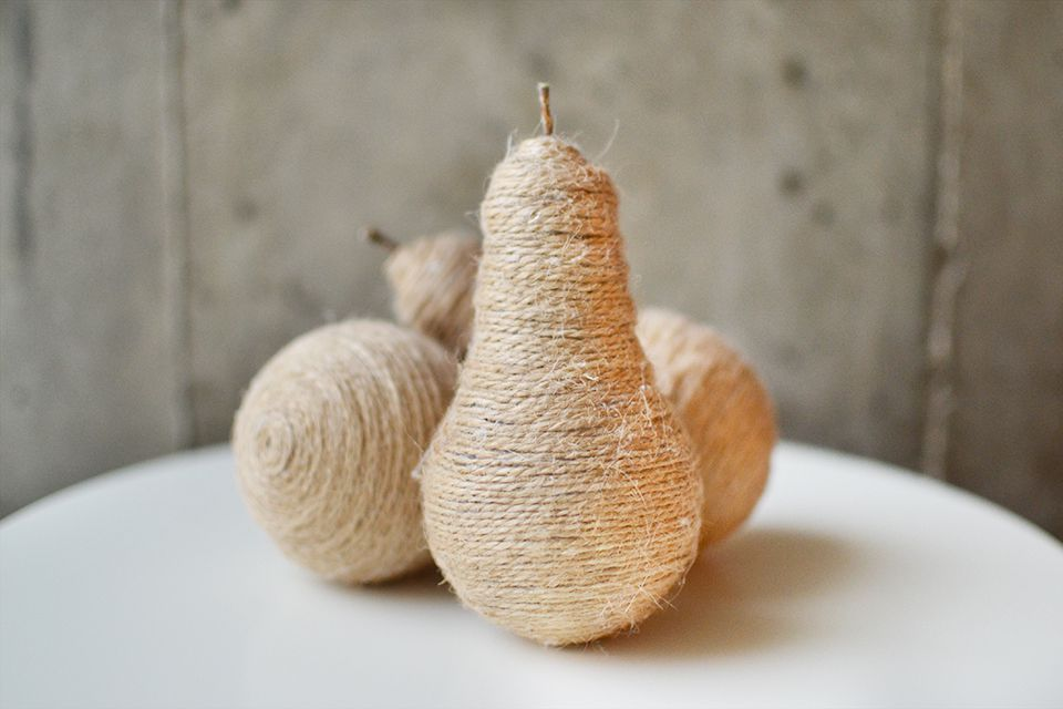 Light bulbs wrapped in twine to look like pears.