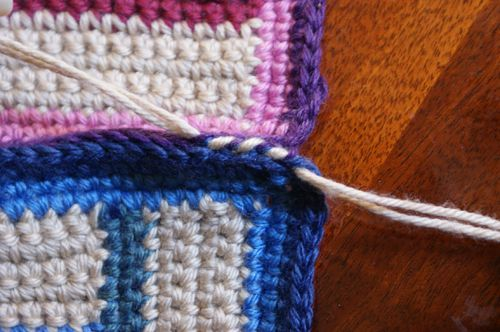 Whip stitch two squares together