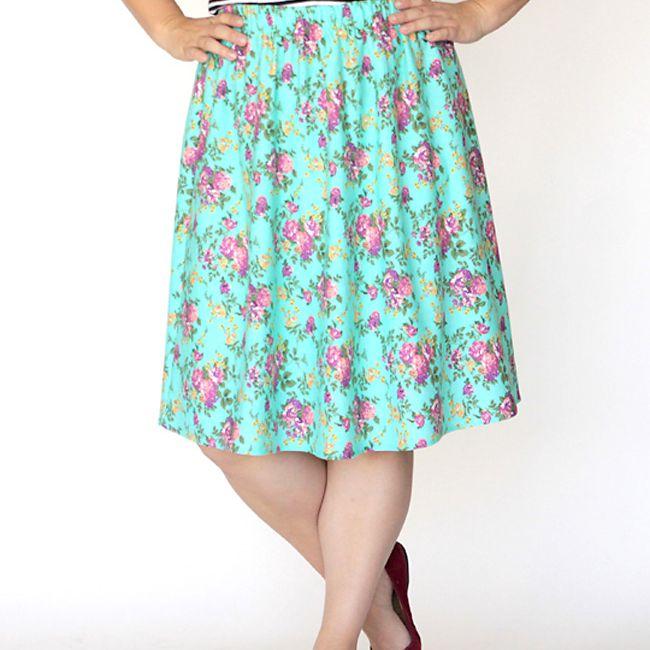 A woman wearing a blue floral skirt