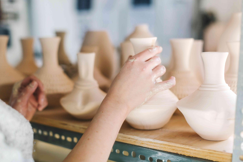 Artist working in pottery studio