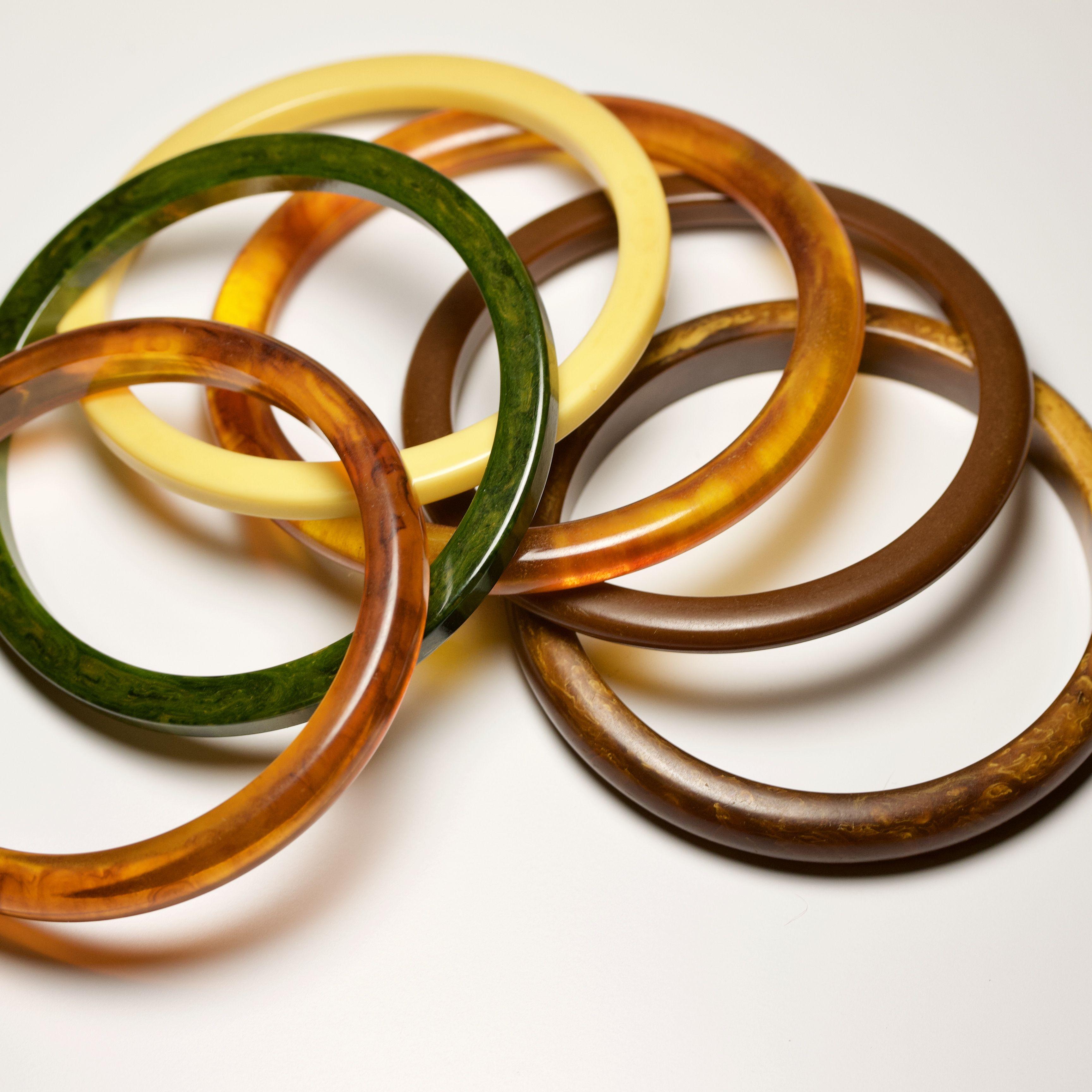 Vintage set-in brass metal on wood round bangle bracelet.
