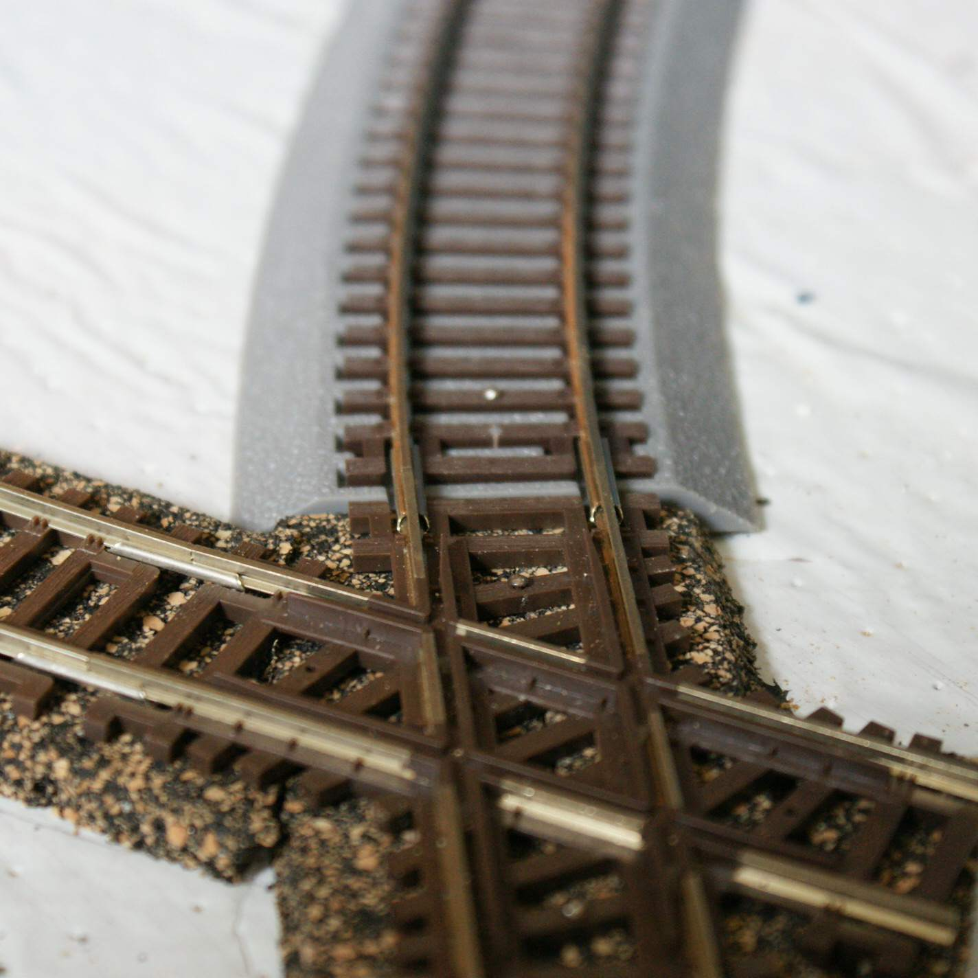 Integrated roadbed tracks and standard tracks can be used together with a little planning and just a few modifications.