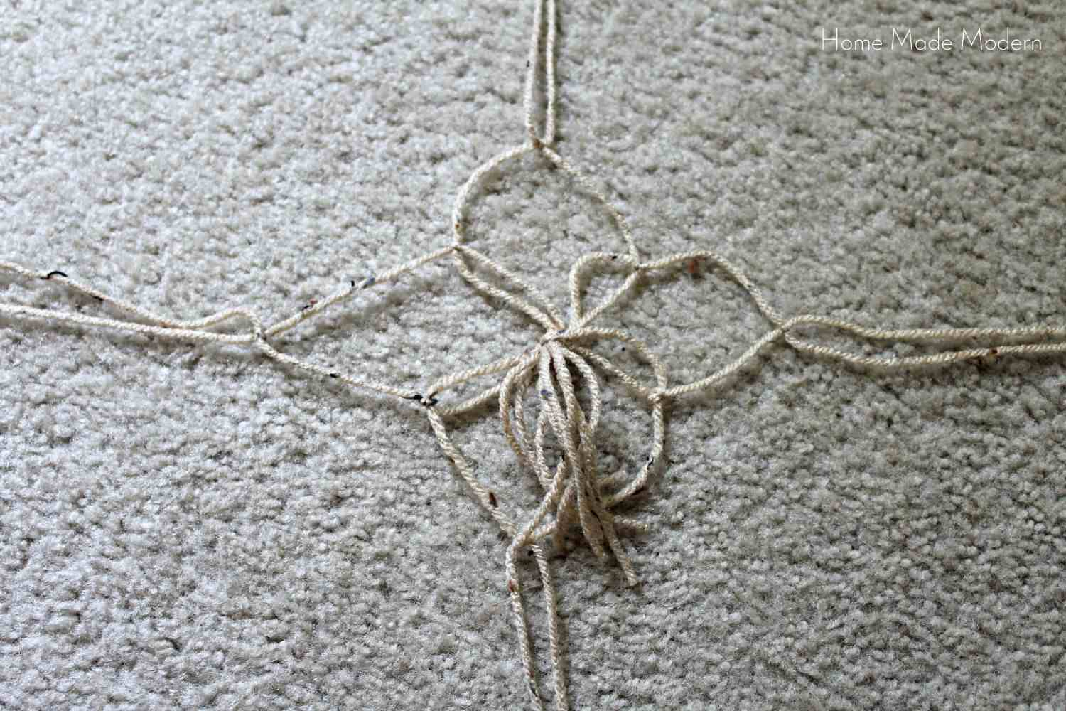 tying the second knot for the macrame hanging plant holder