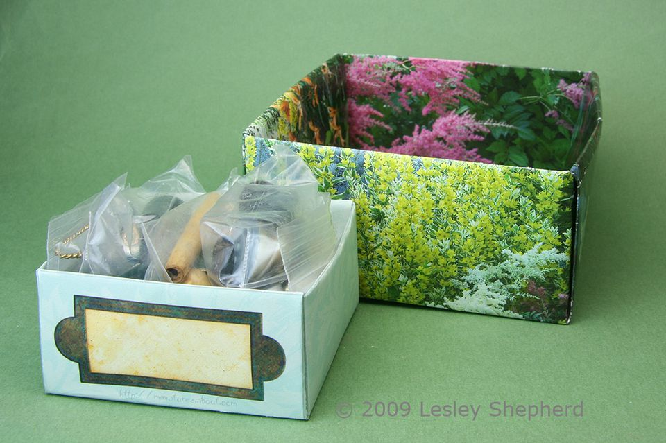 Easily folded paper or card boxes hold a variety of supplies to organize drawers of miniatures.