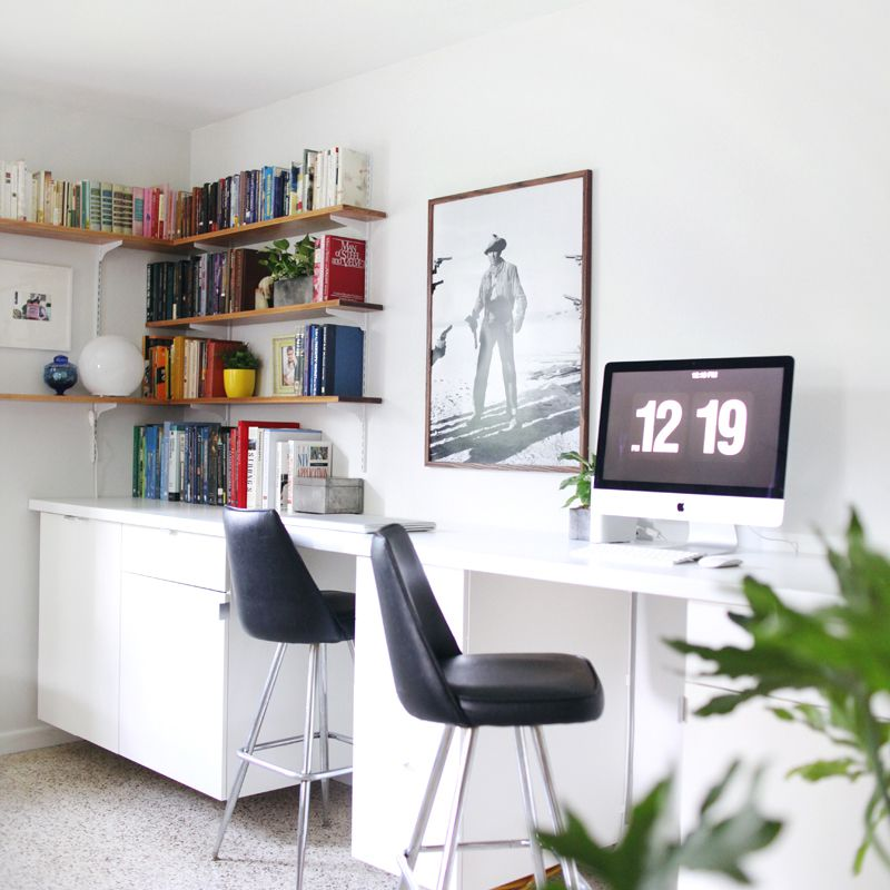 A living room with built-in desks