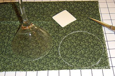 Trace a circle on a piece of fabric using a glass