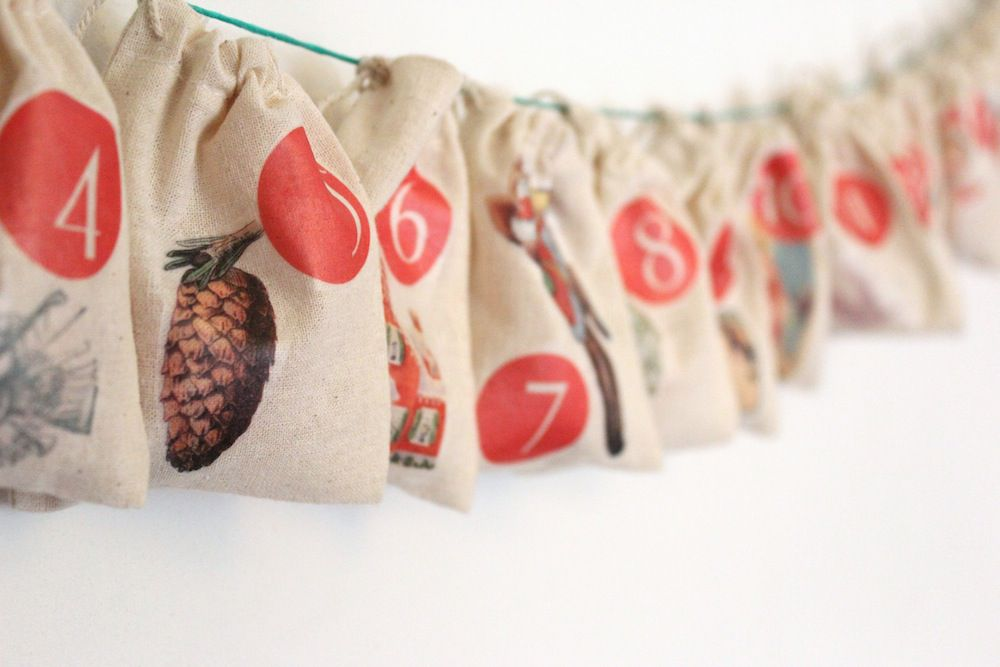 Small drawstring bags with festive designs on them.