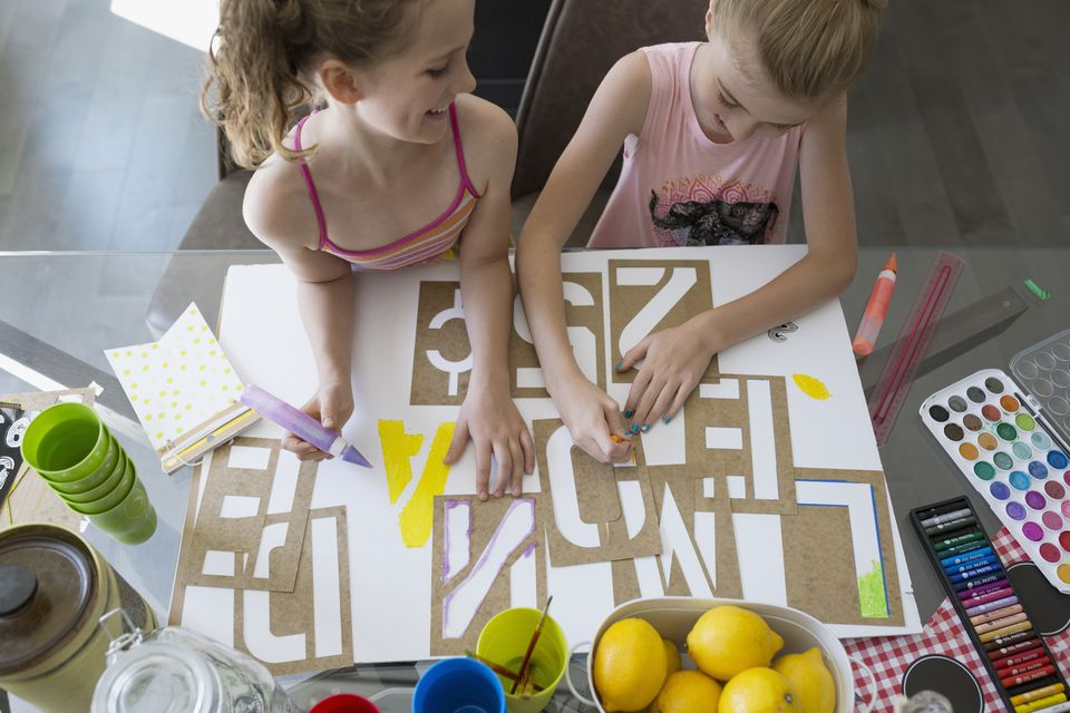 Girls using letter stencil