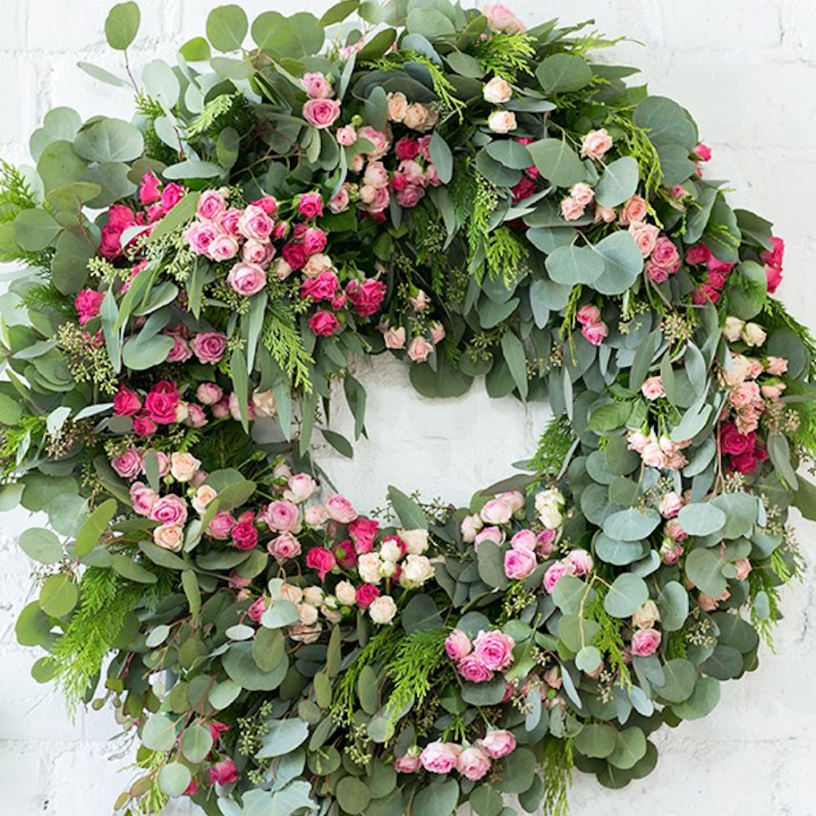 beautiful oversized wreath made with florals and greenery