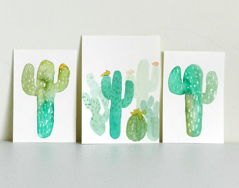 Watercolor cactus paintings on various sizes of cardstock