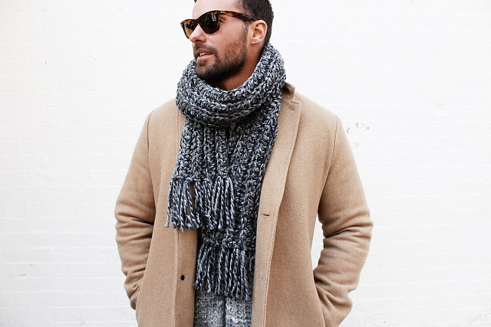Man wearing a crocheted scarf