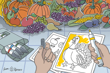 An illustration of a child coloring a turkey coloring page