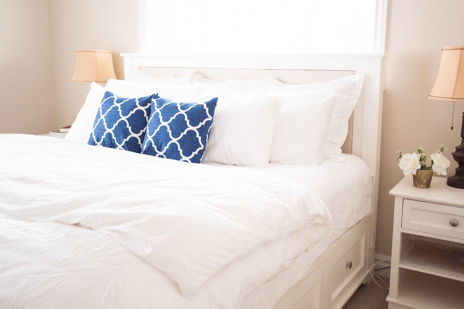 A platform bed with blue pillows