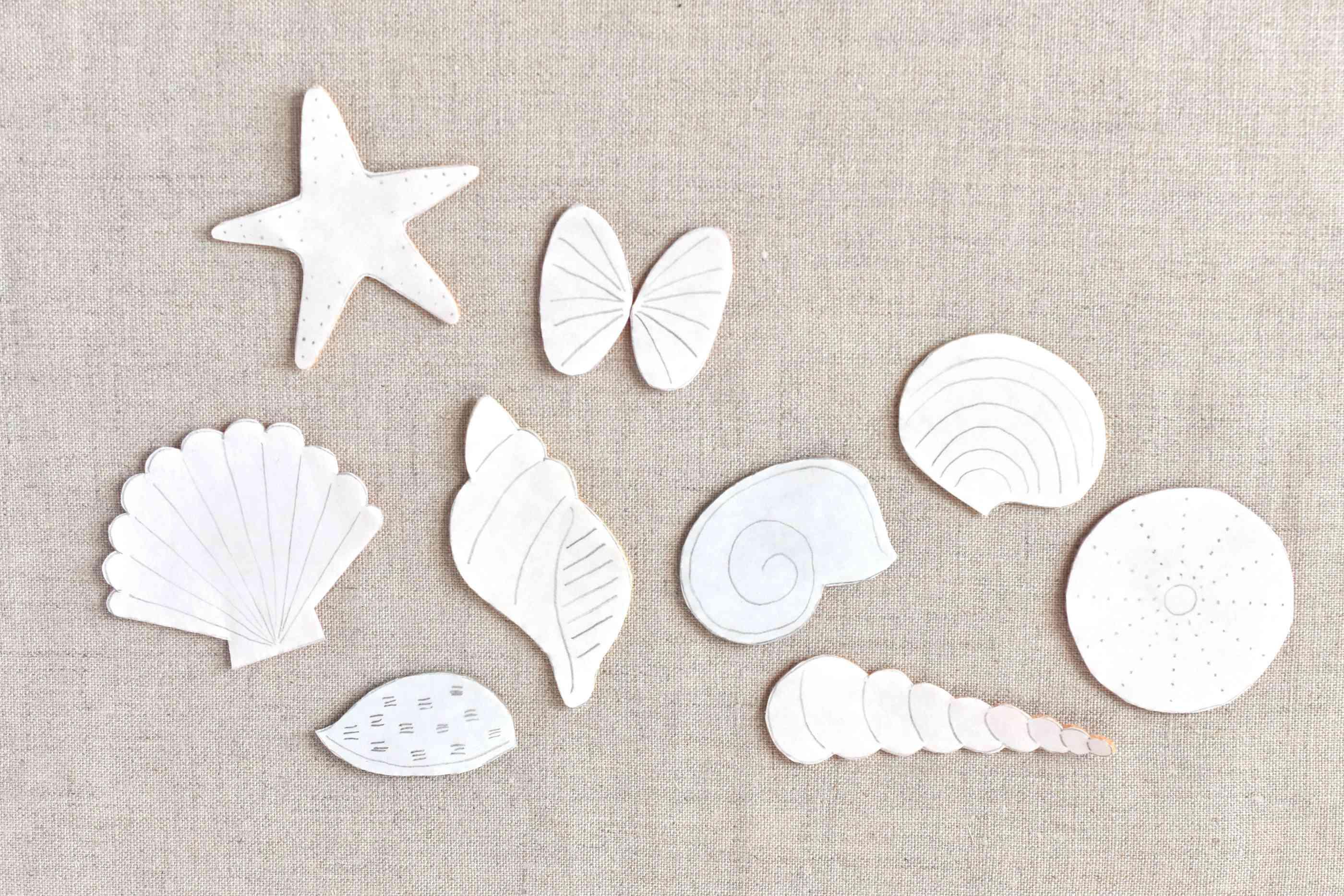 felt seashells arranged on fabric