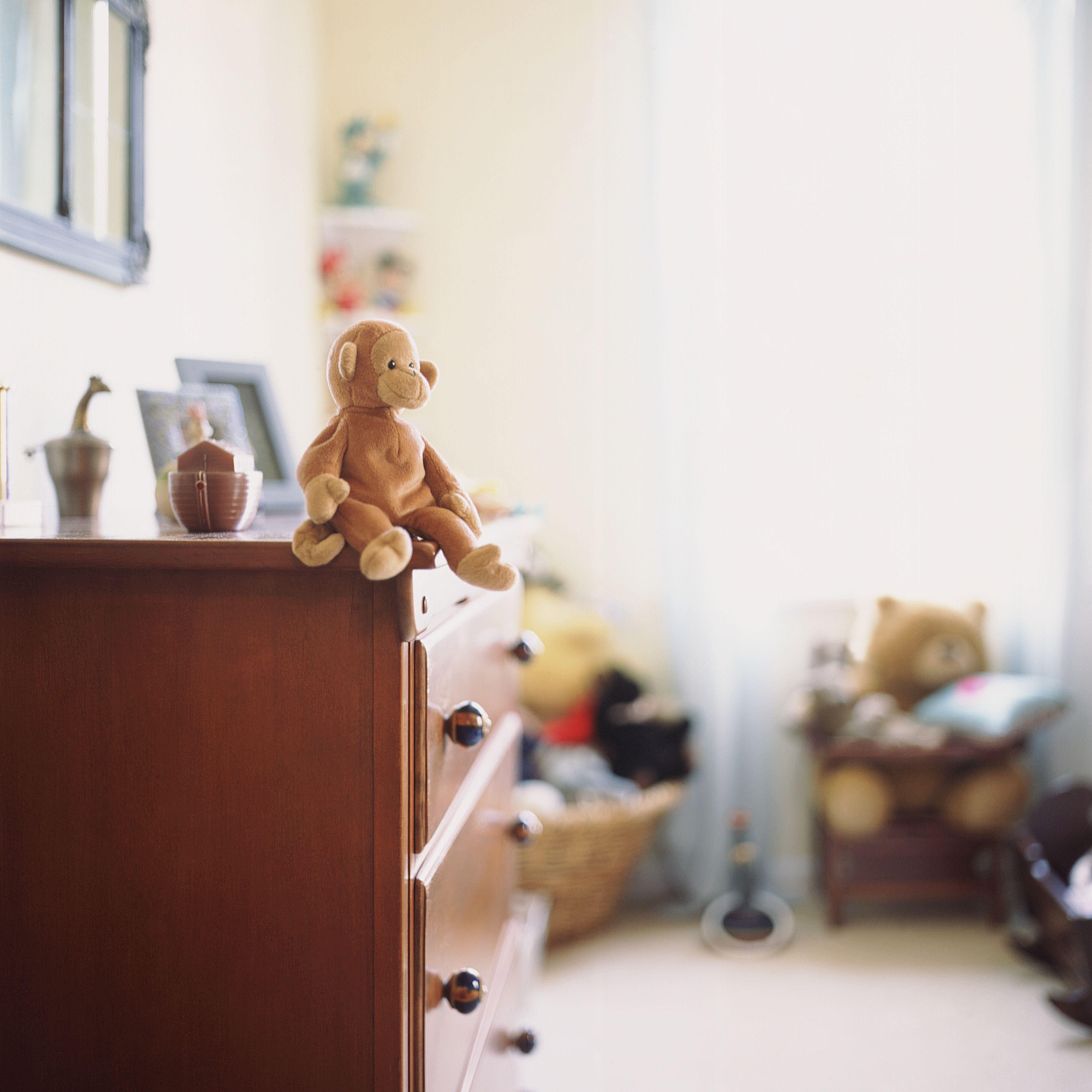 Child's bedroom (focus on stuffed toy on dresser)