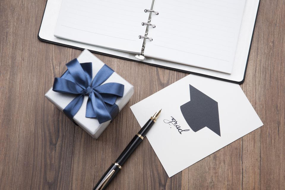 A gift next to a notebook