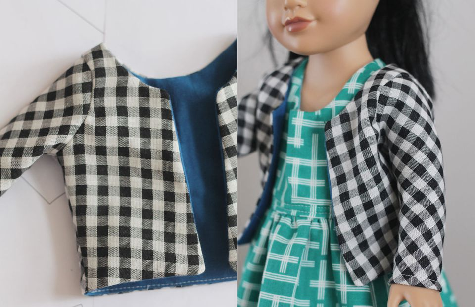 Black-and-white doll jacket with a doll.