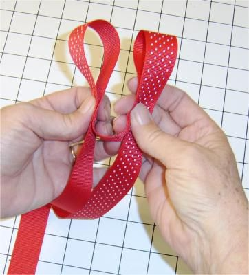 Forming the loops of ribbon for a bow