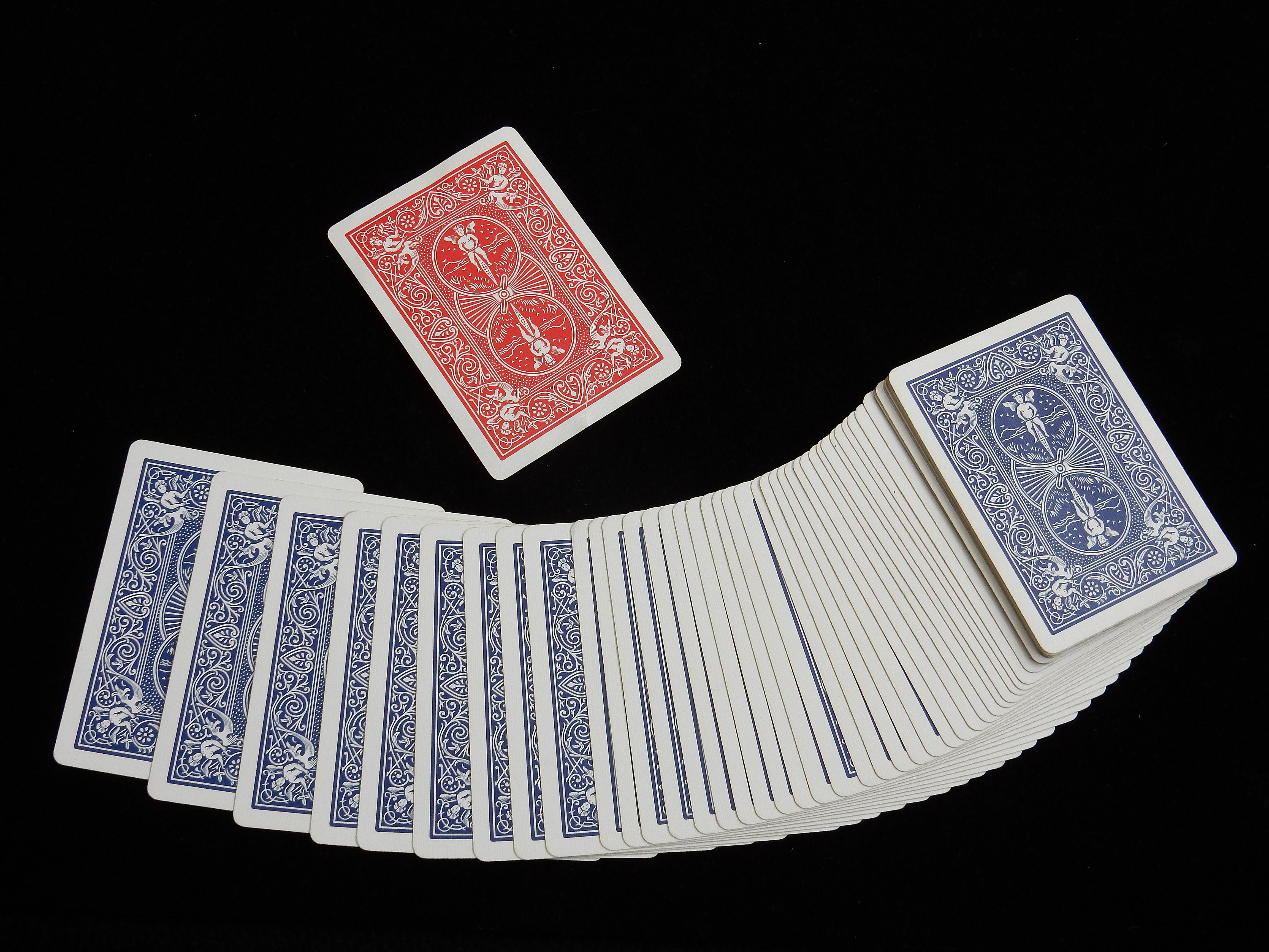 Blue deck of cards with one red card