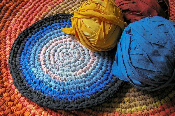 Colourful crochet rag rugs in sunlight