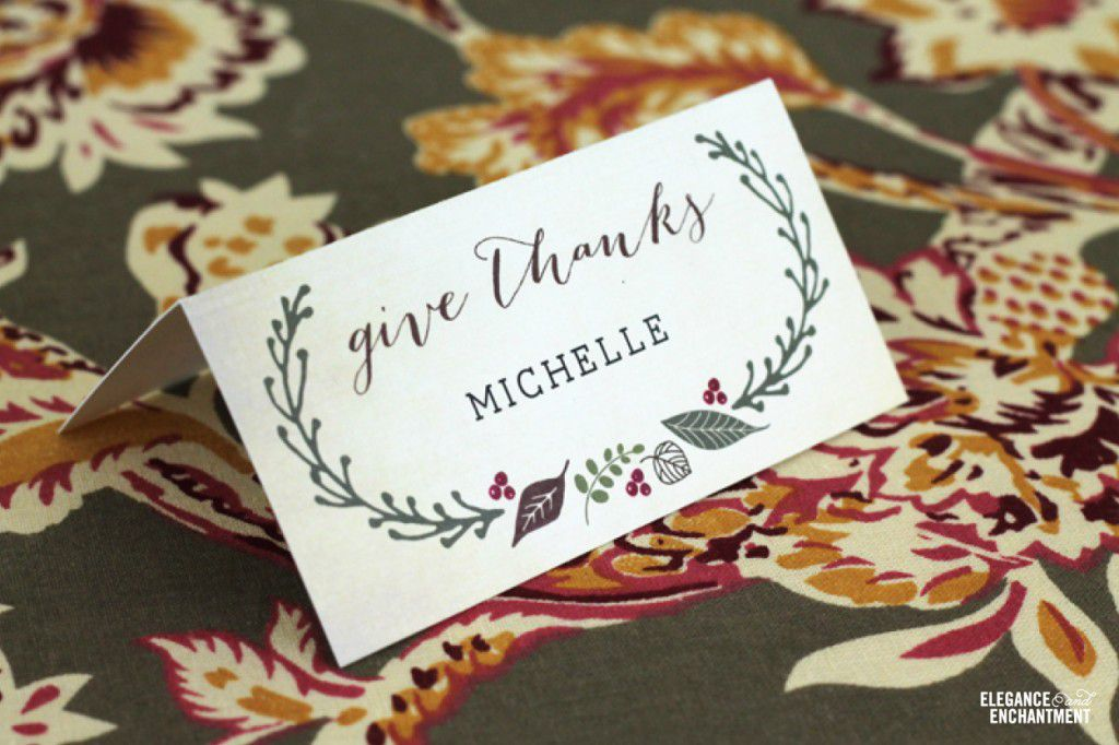 place cards with leaves and berries