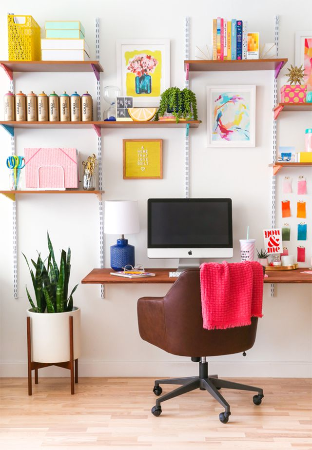 A craft desk with bookshelves