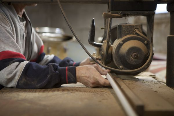 Man using radial arm saw
