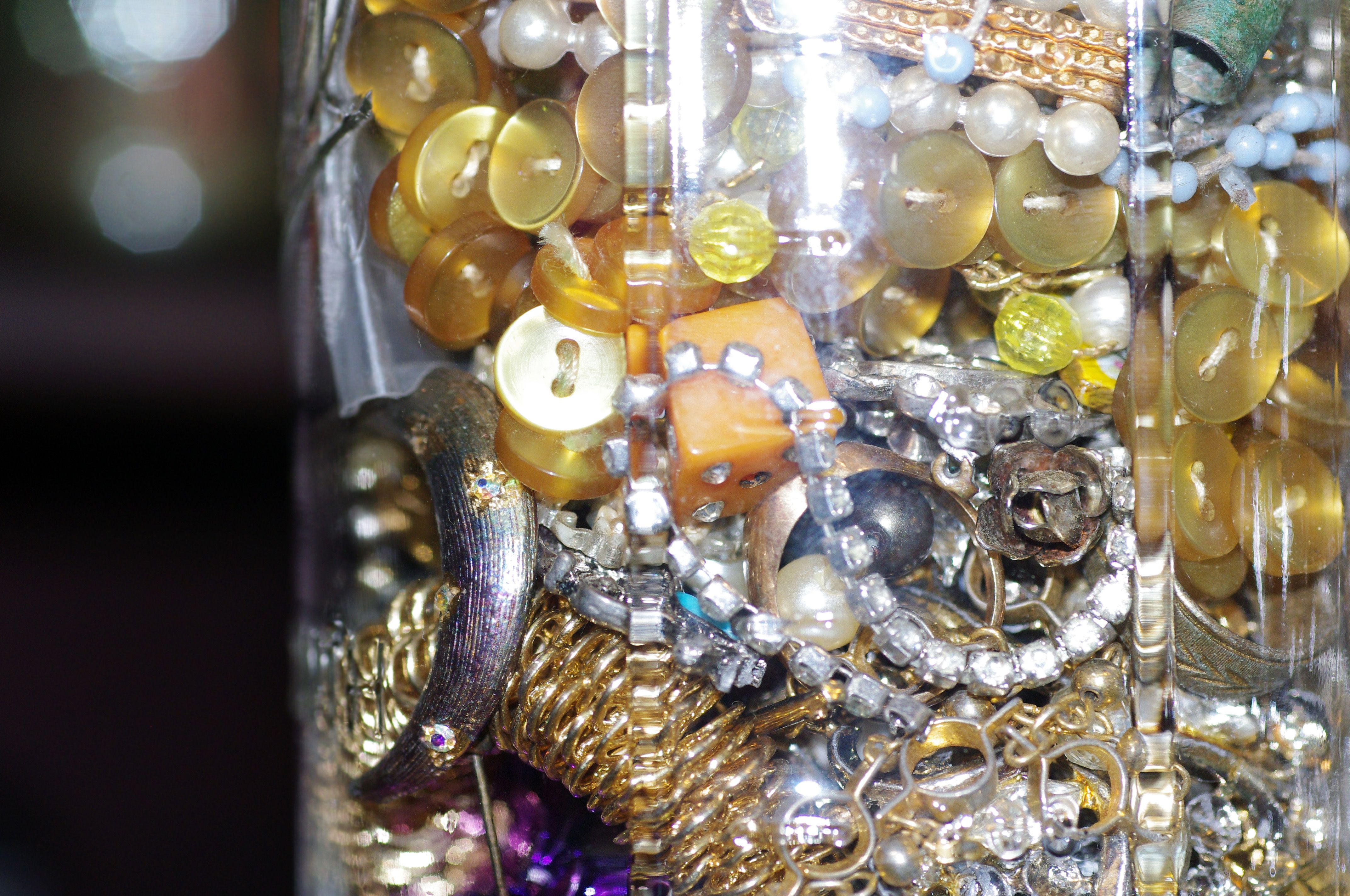 Close-Up of an Old Jar of Buttons and Jewelry