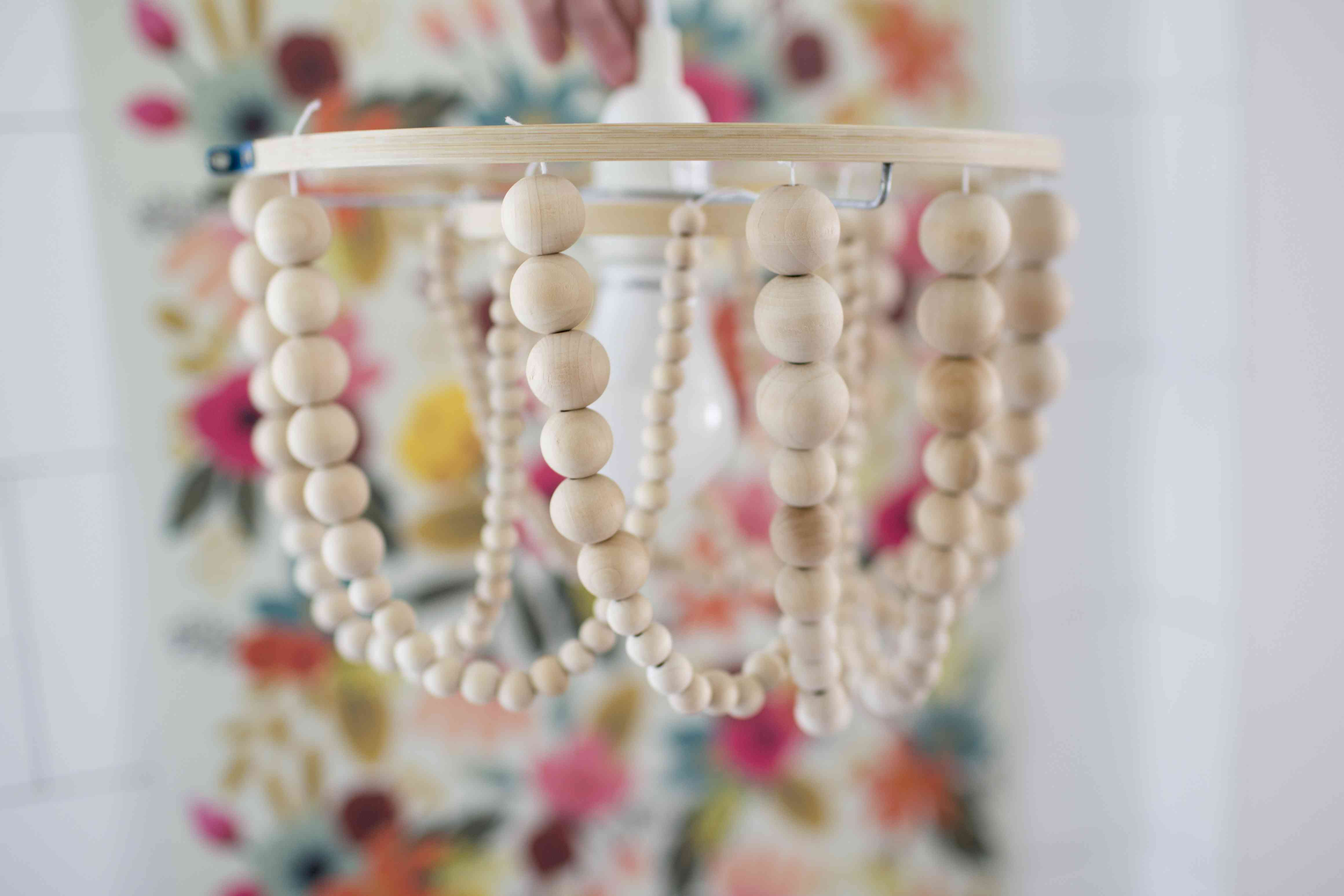 Close up of wood bead chandelier.