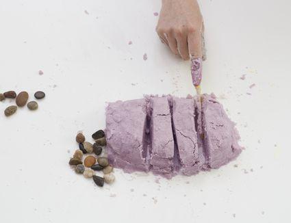 Person cutting through DIY kinetic sand