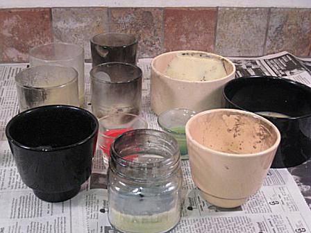 Dirty, used candle containers
