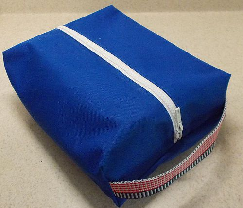 A blue sewn shoe/craft bag