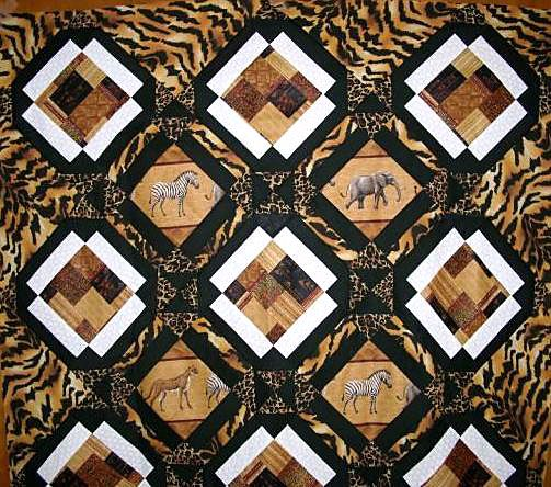 Animal print fabric on a baby quilt with images of animals.