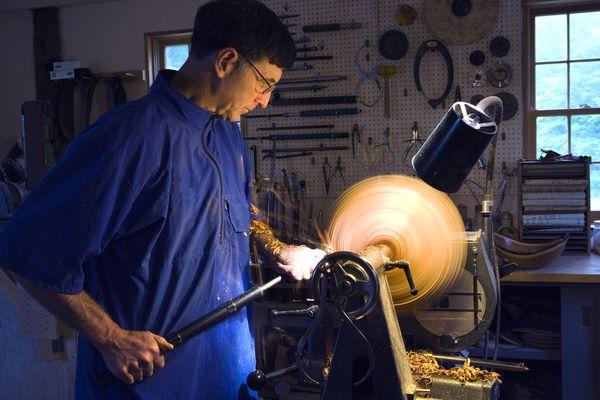 Man turning a bowl on a lathe