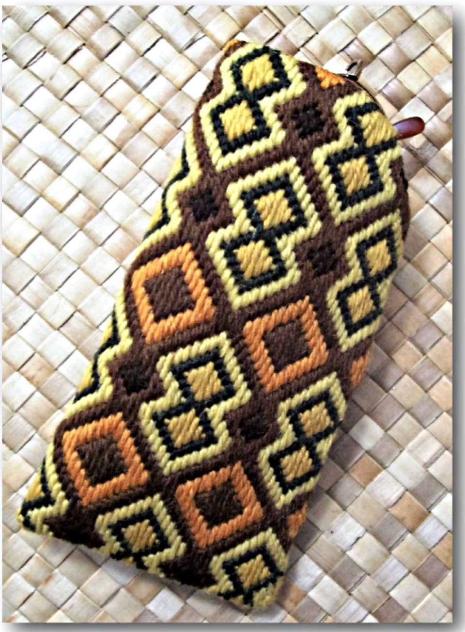 Needlepoint eyeglass case with African themed pattern
