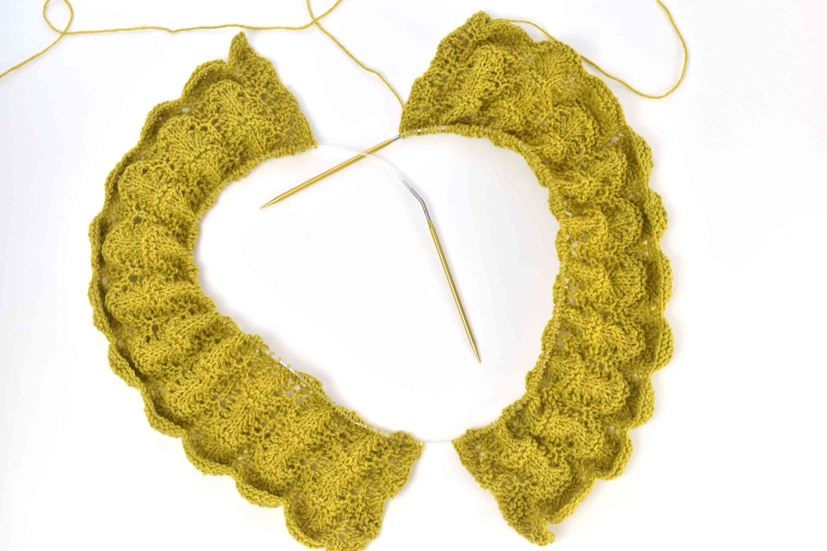 Two lacy knit sections of a tunic