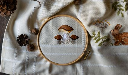 cross-stitch pattern of forest flora and fauna