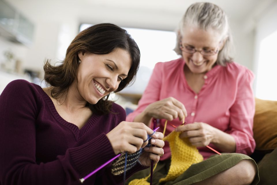 An older woman and a younger woman knitting