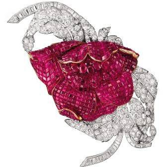 Brooch with invisibly set rubies, diamonds gold and platinum