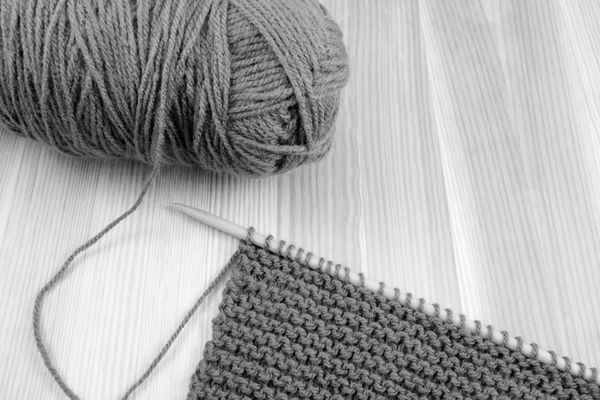 Ball of wool with knitting on the needle