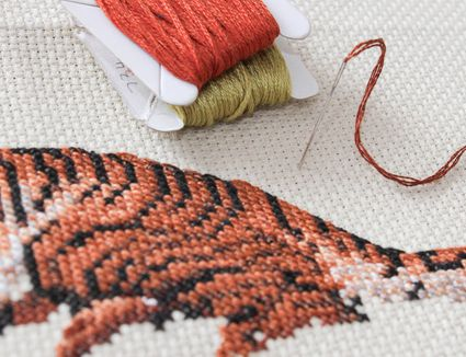 Embroidery pattern with needle and thread
