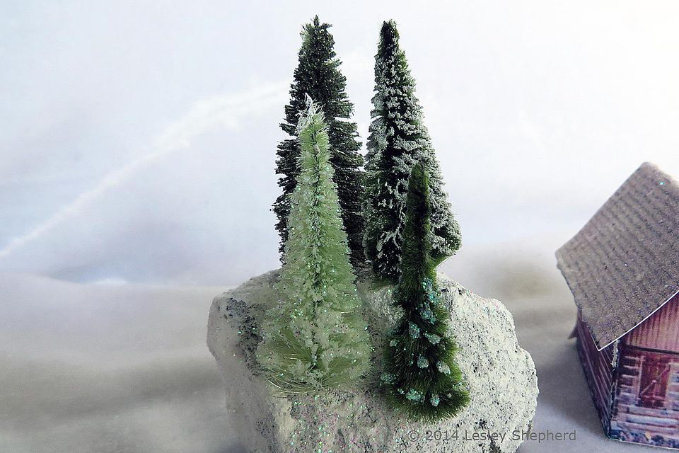 Miniature trees for a glitter village made from vintage chenille bumps.
