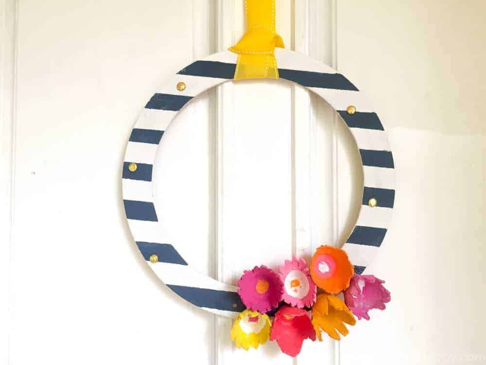 striped cardboard wreath made with egg carton flowers