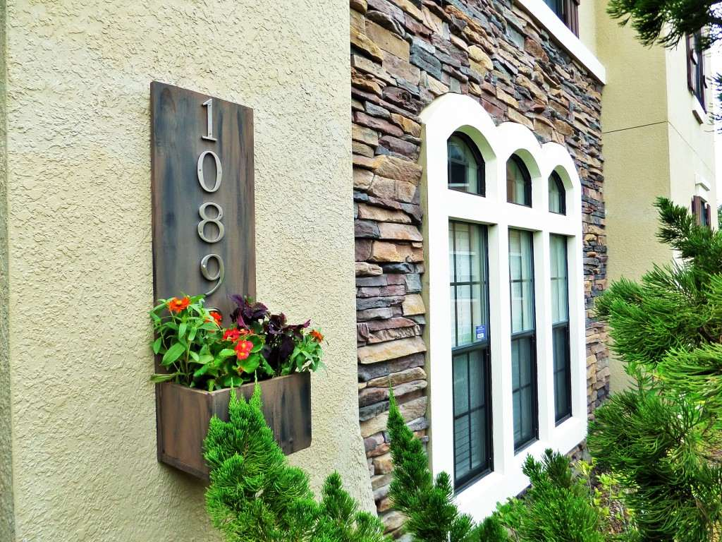 An address plaque with planted flowers