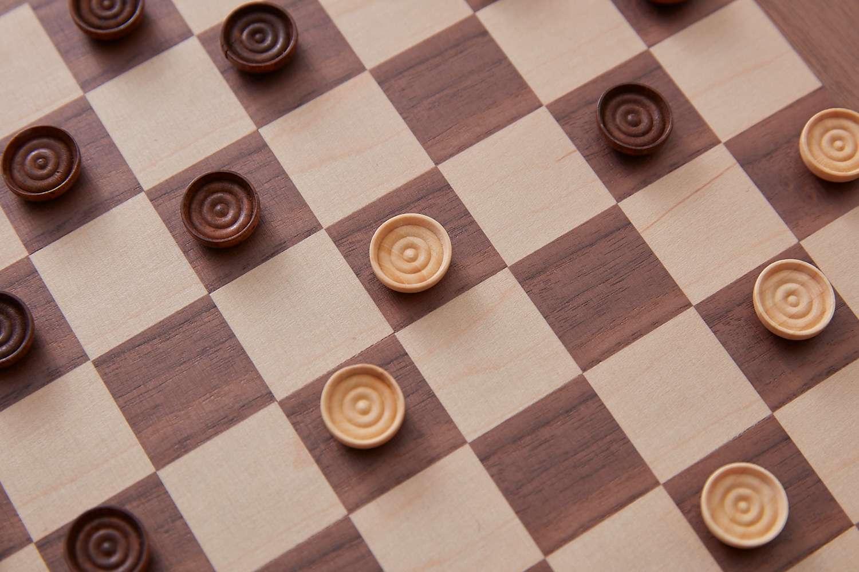 sacrificing a checker for the sake of the game