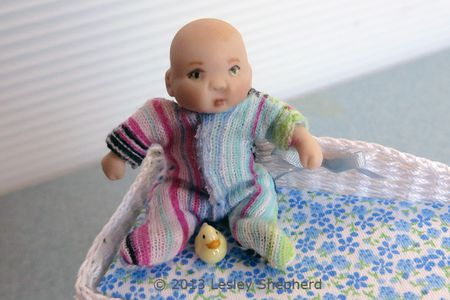 5b141674d Dollhouse baby doll in a custom fitted stretch baby sleeper with a velcro  closure.