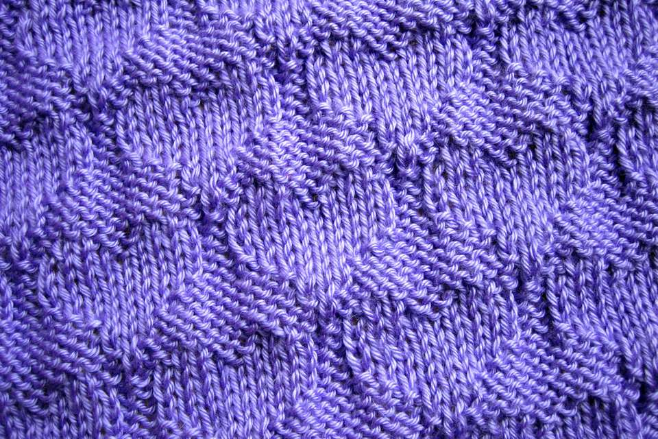 Knits and purls in the ribbing of a baby blanket