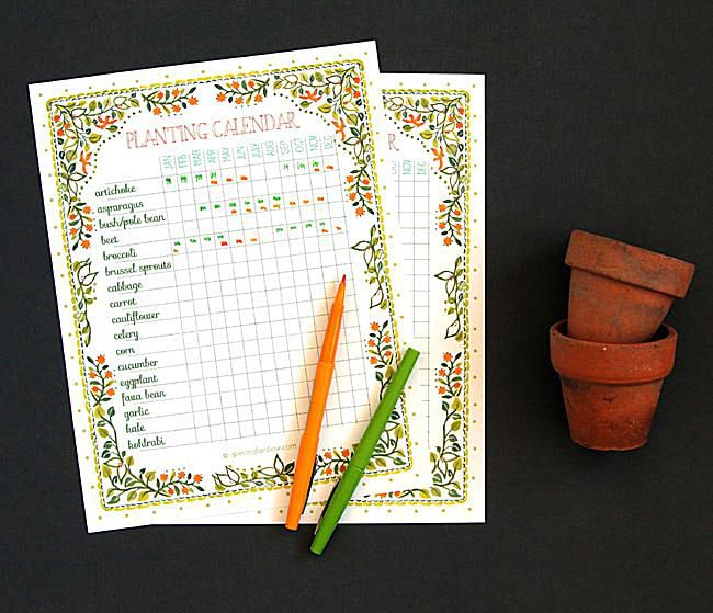 A planting calendar with pencils and pots.