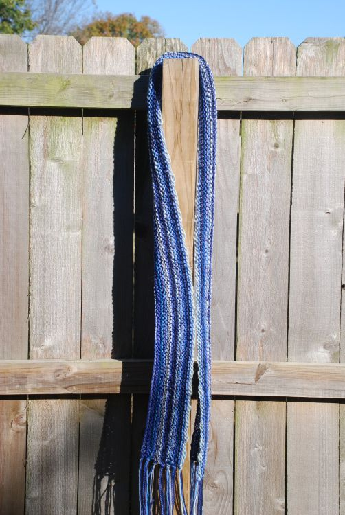 Horizontal Scarf on a wooden fence