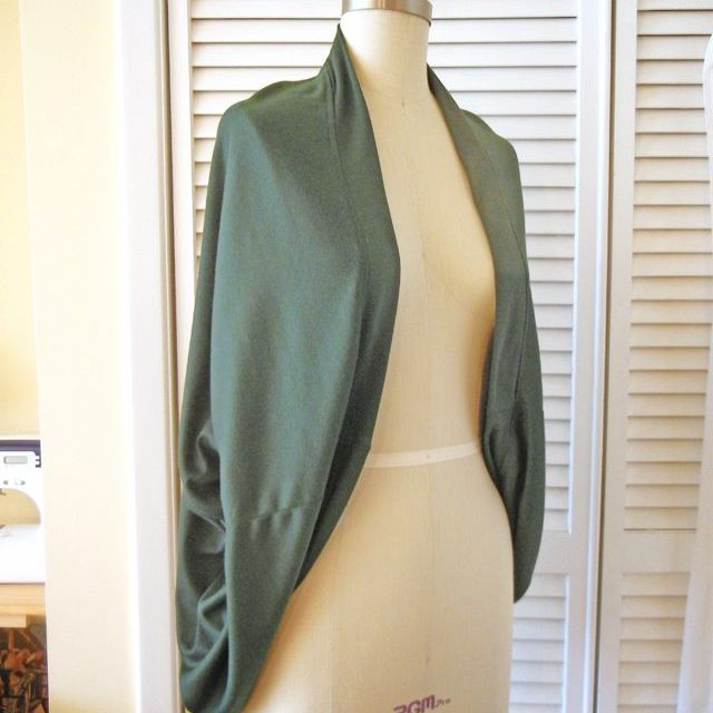 A green cardigan on a mannequin